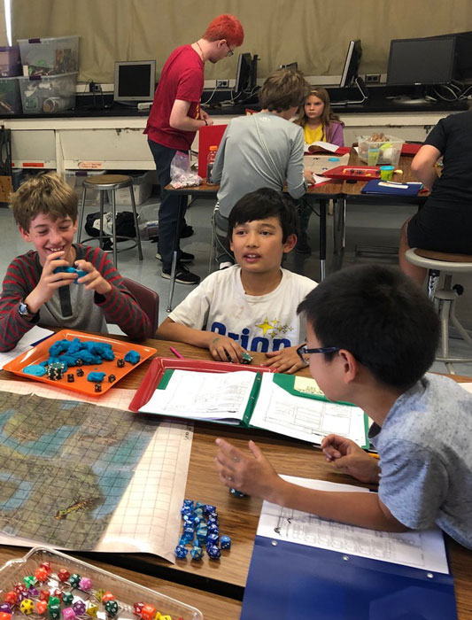 Group of kids at a table playing D&D